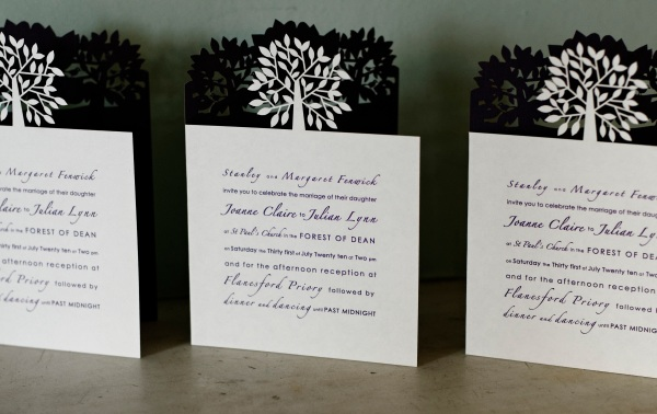 Laser cut tree invitations by Cutture