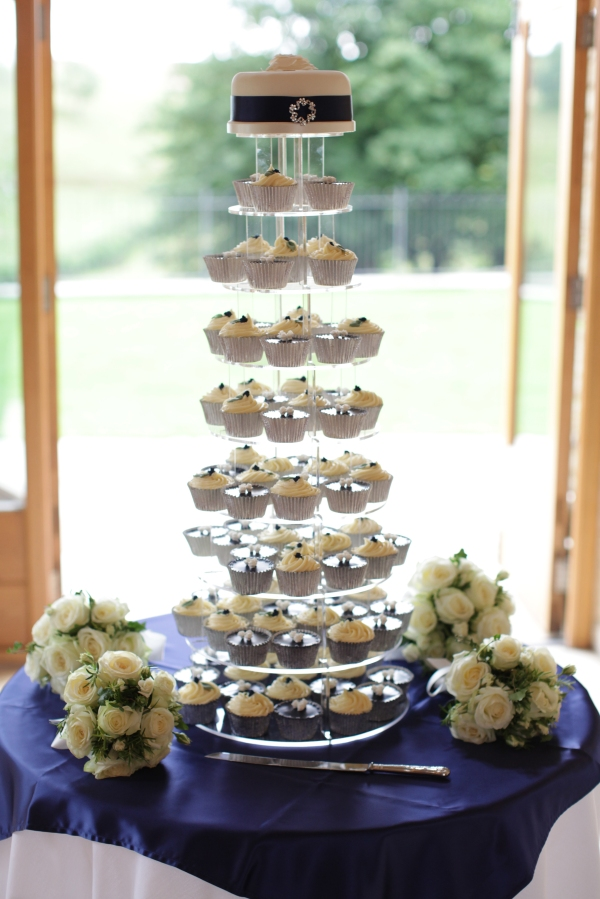 Navy and cream cupcake tower with top tier by Tempting Cake. Image by Bullit Photography