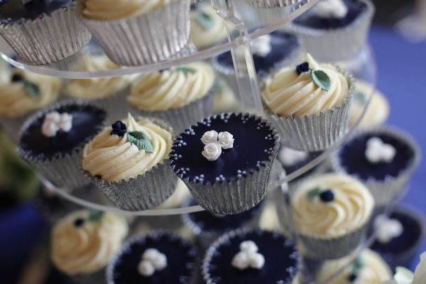 Navy and cream cupcake tower by Tempting Cake. Image by Bullit Photography