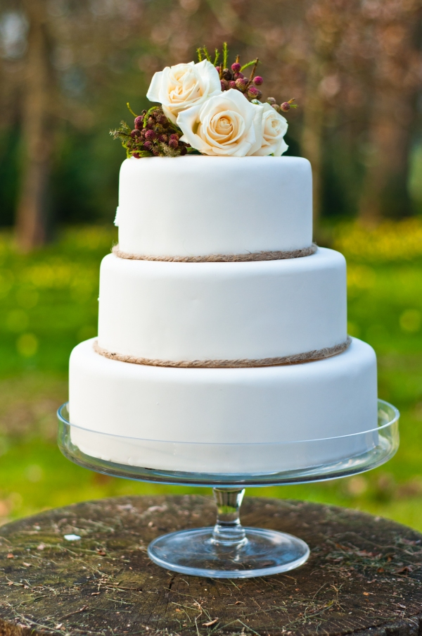 Classic cream wedding cake by Tempting Cake. Image by Liesl Cheney
