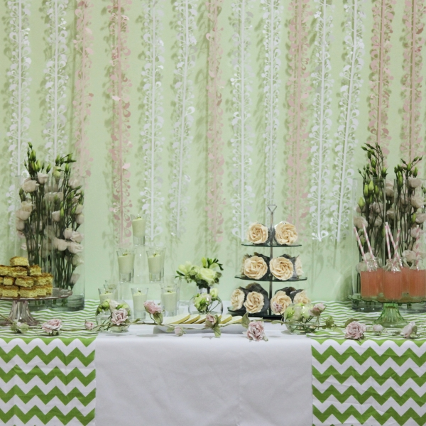 Striking chevron table runners contrasted with the pastel pink frou-frou detail. Image by Charlotte Fielding