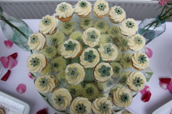 Mini cupcakes with green floral decorations. Image by Tempting Cake.