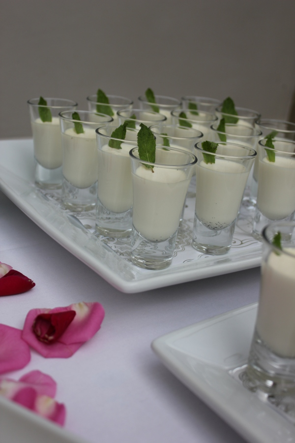 Vanilla panna cotta with fresh mint leaf garnish. Image by Tempting Cake.